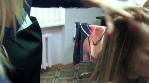 Turn view of stylist hands cut hair and customer girl face Footage