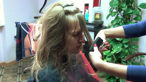 hairdresser brush with comb wet hair cuts the large part hair Footage