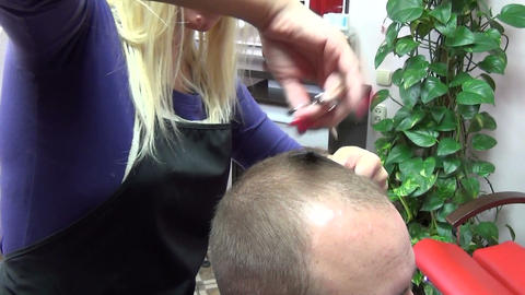barber woman cut customer man hairs with scissors in salon Footage