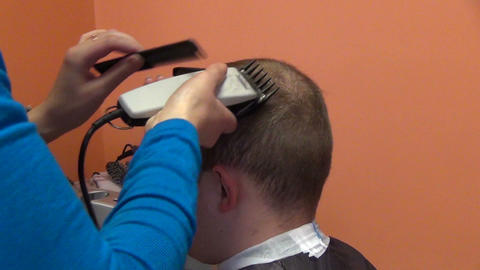 Zoom out customer man head and hairdresser make hair dress Footage