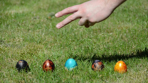 Traditional family Easter game with painted eggs on grass Footage