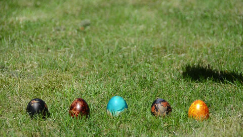 family Easter game with painted colorful eggs on grass Footage