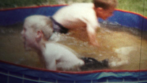 1957 - Boys Playing In Small Splash Pool Footage