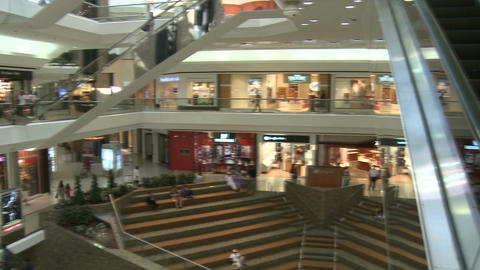 Panning from elevator to escalator within mall Footage