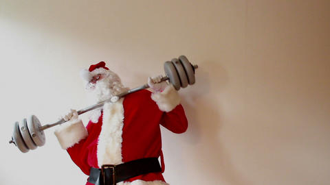 Santa Claus Trying Lift Heavy Weights And Collapsing stock footage