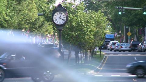 Big clock on the median strip on Main Street Footage