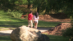 Young couple walking through a park Footage