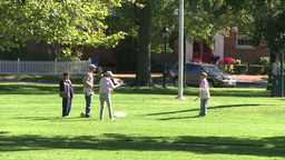 Kids playing with paddle boards on grassy area (1 of 2) Footage
