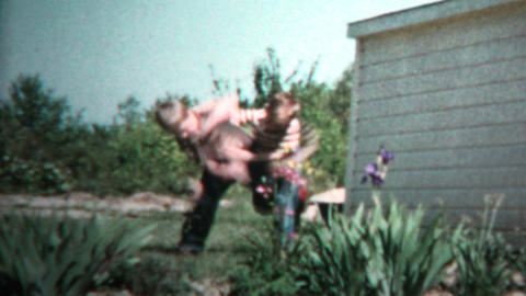 1957 - Young Brothers Matching Outfits Wrestling For Sport Footage