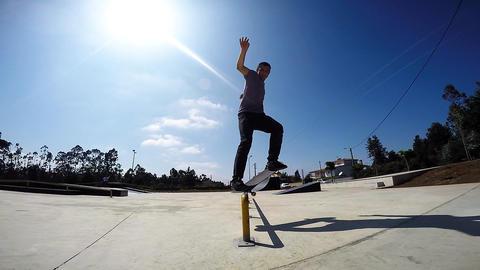 Skateboarder grinding down rail Footage