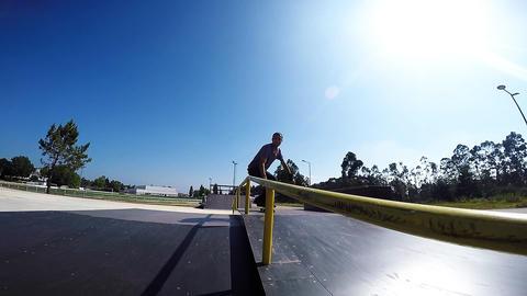 Skateboarder sliding down rail Footage