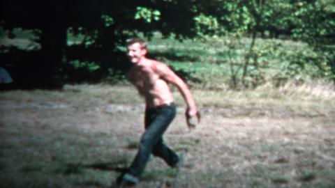 1958 - Shirtless Man Tossing Horseshoe Practice Game Footage