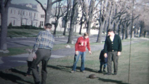 1958 - Holiday Family Football Game Public Park Footage
