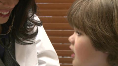 Female nurse checks child's breathing (1 of 5) Footage