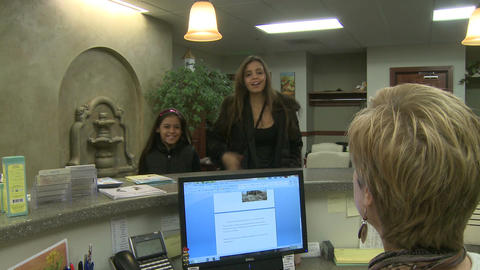 Mother and daughter check-in at doctor's office Footage