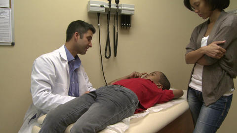 Male doctor examines sick child (3 of 4) Footage