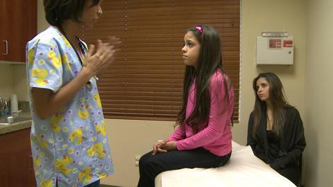 Nurse checks patients vitals Footage