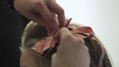 Creating hairstyles hairdresser with bow Footage