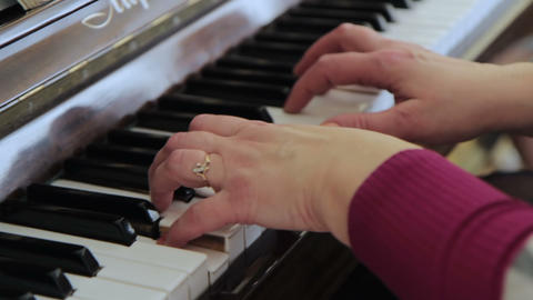Woman's hands on the keyboard of the piano Footage