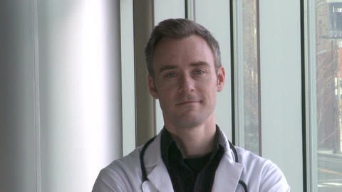 Male Doctor smiles confidently Live Action