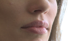 Closeup of woman's mouth as she converses (3 of 3) Footage