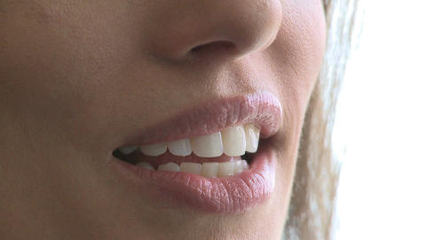 Closeup of woman's mouth as she converses (1 of 3) Footage