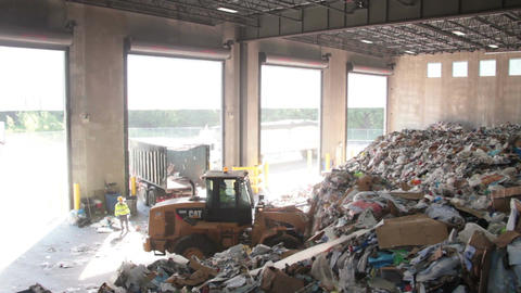 A Front End Loader Moves Trash at a Recycle Center ( 6 of 9) Footage