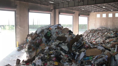 A Front End Loader Moves Trash at a Recycle Center ( 5 of 9) Footage