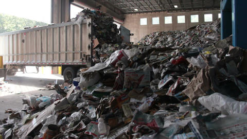 A Truck Dumps Trash to be Recycled (7 of 10) Footage