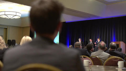 Back of businessman sitting in conference Footage