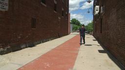 Man walking through an alley Footage