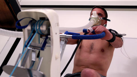 Fit man doing a stress test on exercise bike Footage
