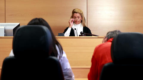 After the trial judge banging gavel on sounding block Footage