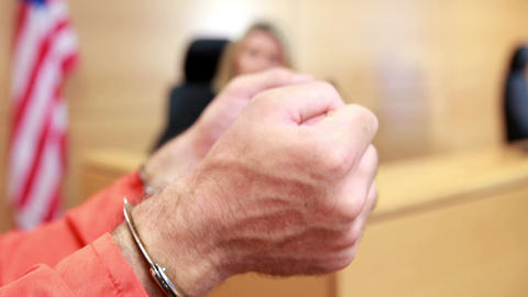 Close up of a criminal hands with handcuffs Footage