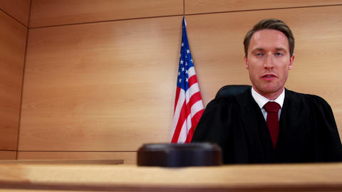 Judge calling order with gavel in american court Footage