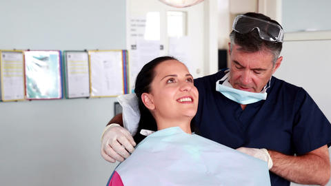 Dentist speaking with his patient Footage