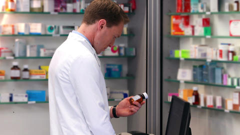 Handsome pharmacist working on computer Footage