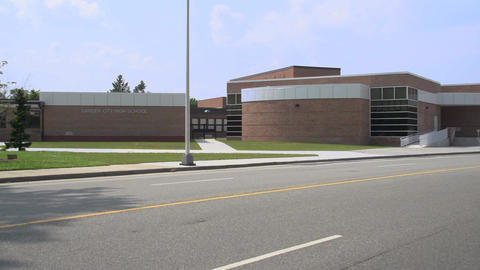 Exterior of sprawling brick school Footage