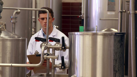 Brewery worker checking the vats Footage