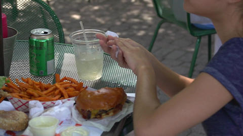 Eating a burger and fries outside (2 of 2) Live Action