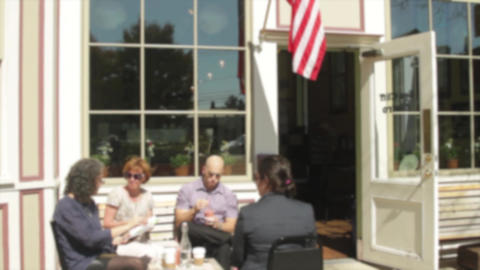 People Sitting Outside A Small Cafe On Sidewalk (3 Of 3) stock footage