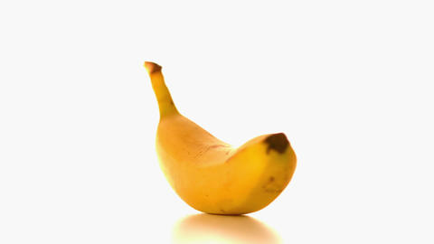 Banana spinning on white surface Footage