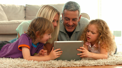 Happy family using tablet together Footage