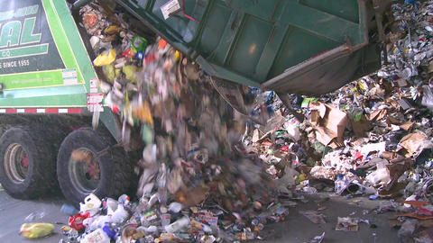 Dump trucks dumping waste (2 of 11) Footage