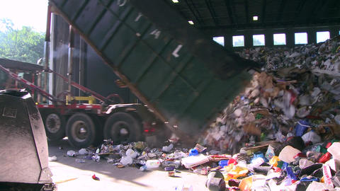 Dump trucks dumping waste (10 of 11) Footage
