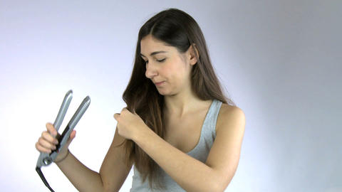 Girl having bad hair day ironing her very long beautiful... Stock Video Footage