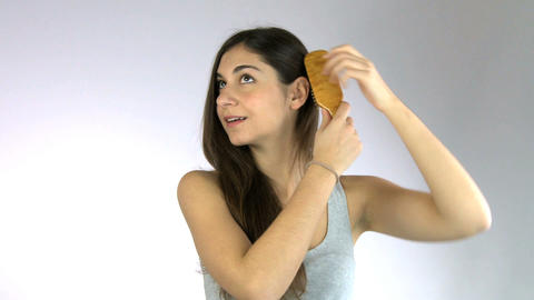 Girl brushing hair and showing thumb up Stock Video Footage