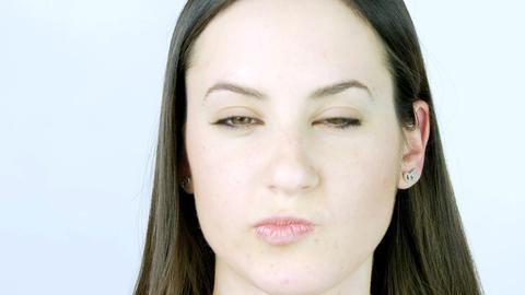 Closeup of attrattive female brunette model thinking sad Stock Video Footage