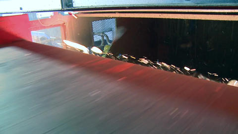 Slo-mo Of Red Waste Facility Conveyor (3 Of 9) stock footage