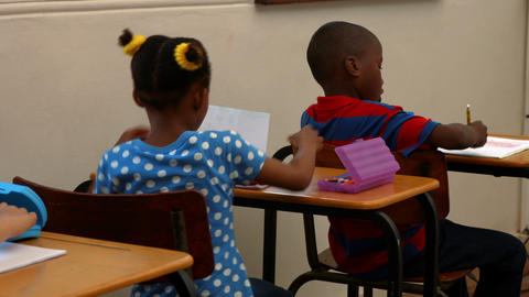 Cute schoolchildren in the classroom Footage